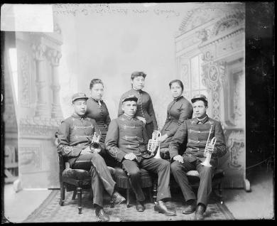 Three male student band members and three female students, c.1890