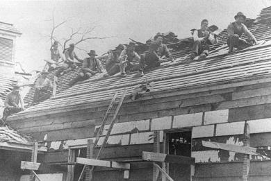 Indian School students and staff working on roof of a building, 1880