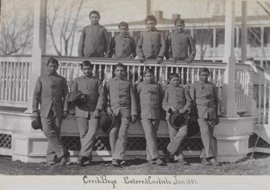 Ten male Creek students posed at the bandstand [version 2], 1881