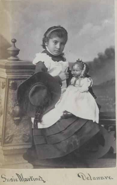 Susie Martinez holding a doll [version 3], c.1883
