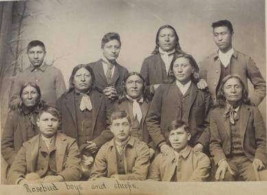 Six Sioux chiefs with six male students [version 2], c.1890