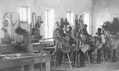 Students and staff in the harness-making shop, c.1880