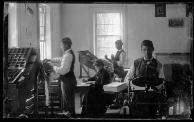 Students and Marianna Burgess in the print shop, c.1881