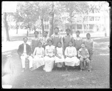 Eleven unidentified Alaskan students with a white man, 1901