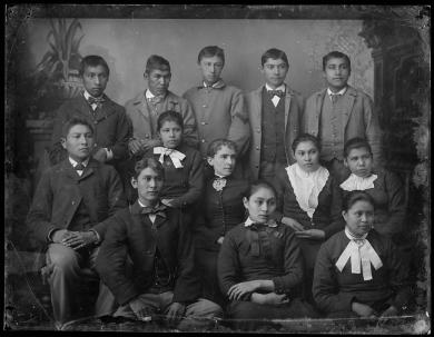 Twelve unidentified students with a female teacher, c.1882