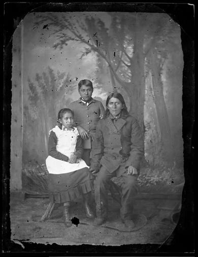 Native American man with a male and a female student, c.1881