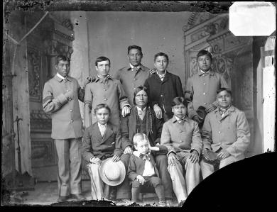 Standing Bear with eight male students and one young white boy, c.1881