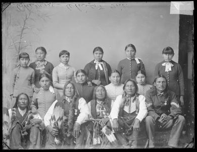 Five visiting Cheyenne chiefs and ten female students, c.1885