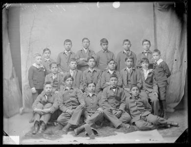 Seventeen unidentified male students with two white boys, c.1887