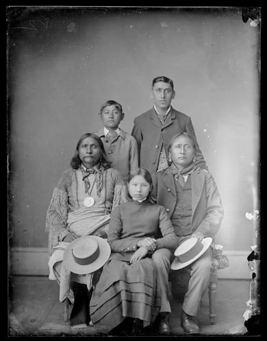 Julia Given, Joshua Given and Otto Zotoum [?] with two visiting chiefs, c.1882