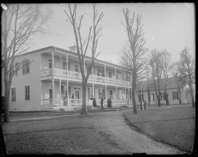 Pratt family in front of the Superintendent's Quarters [version 1], c.1881