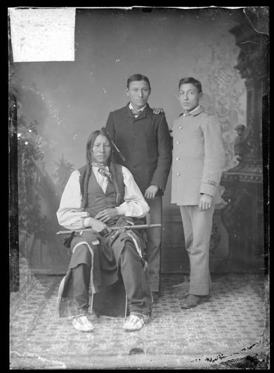 Young Bull Bear, a visiting chief, with Oscar Bull Bear, and Richard Davis, 1879
