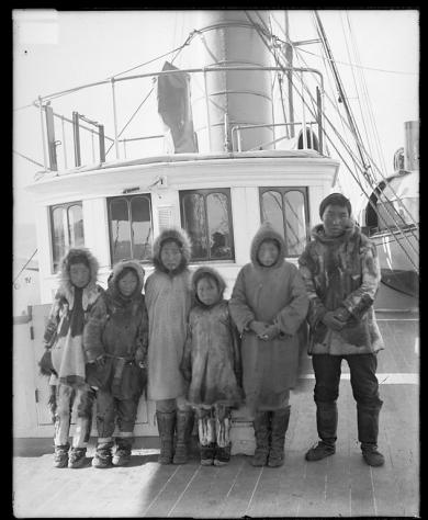 Six Alaskan students aboard a ship  [version 1], 1897
