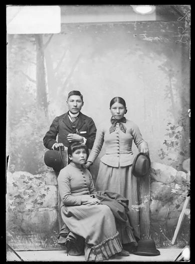 Lucy Tsisnah, Virginia Nahaklo and an unidentified young man, c.1888