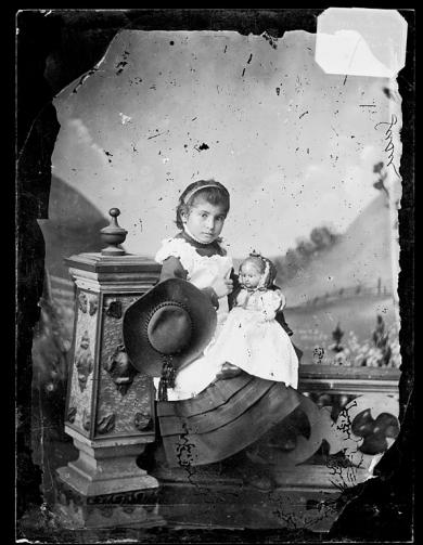 Susie Martinez holding a doll [version 1], c.1883