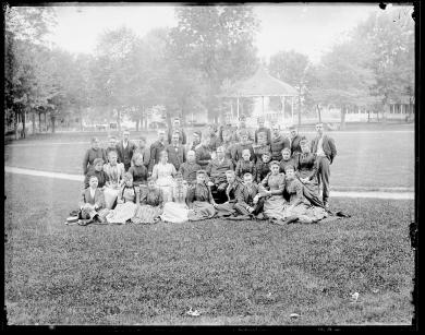 T.J. Morgan, Commissioner of Indian Affairs, with Richard Henry Pratt and teachers [pose 2], c.1890