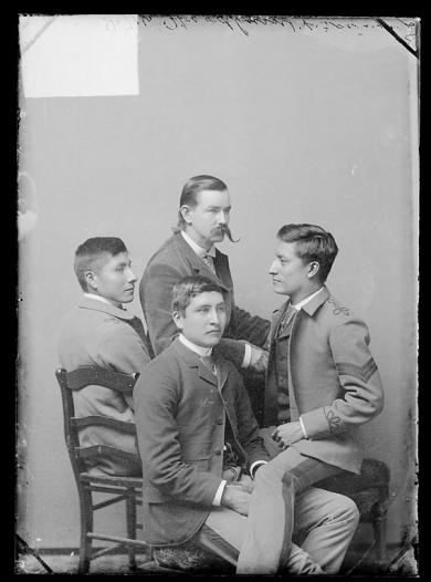 Three male students with J.M. Woodburne, c.1889