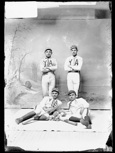 Four young men in baseball uniforms [version 1], c.1888