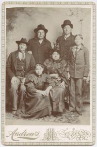 Male student and female student with vistitors, c.1890