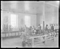 Students working in the tin shop with instructor, c.1881