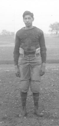 Bruce Goesback in football uniform, c.1911