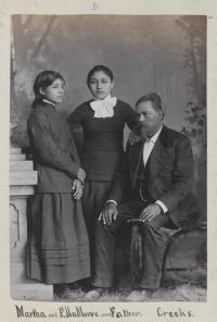 Martha Moore and Ella Moore with their father, John R. Moore [version 2], c.1882