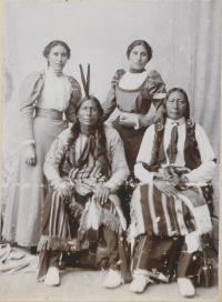 Two chiefs with two female students, c.1897