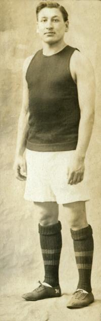Louis Dupuis in basketball uniform, 1911