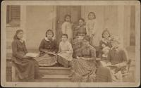 Students sit outside the Girls Quarters