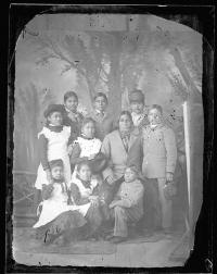 Native American man with nine students [version 1], c.1882