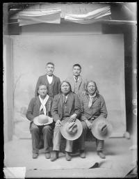 Charles Smith with three visiting chiefs and one male student, c.1891