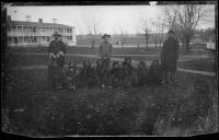 Three male students with eight students who have just arrived, c.1883
