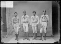 Four young men in baseball uniforms, c.1889