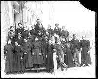 Male and female students with two female teachers, c.1890