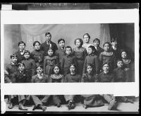 Twenty-one unidentified students with one white woman, c.1897