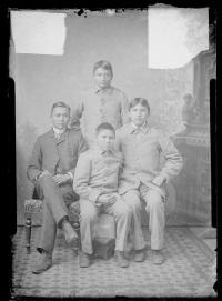 Wood Nashozey and three male Apache students, c.1890