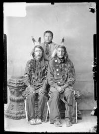 Charles Smith with two unidentified young men in native dress, 1887