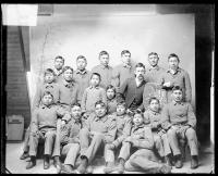 Seventeen male Cheyenne students with a white man, 1890