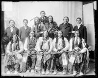 Seven visiting chiefs with two older Native American men and three male students, c.1890