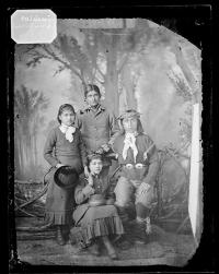 Benjamin Thomas with two unidentified female students and a visitor [?] [version 1], c.1884