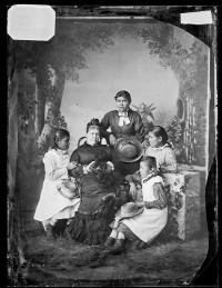 Mary Ealy, Nellie Carey, Mary Perry, and Jennie Hammaker with teacher Mary Hyde [version 1], c.1881