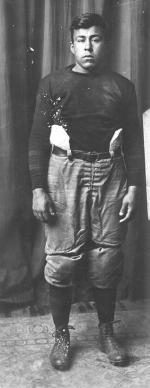 Joseph Bergie in football uniform, c.1911