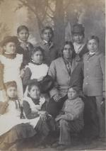 Native American man with nine students [version 2], c.1882