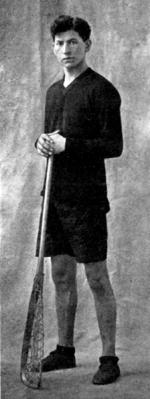 Edward Bracklin with lacrosse stick, c.1910