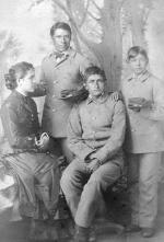 Three male Pueblo students with Miss Shields [version 2], c.1883