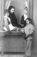 Lena Carr and Harry Marmon with staff [version 2], c.1882