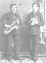 David McFarland and Ben Harrison holding musical instruments, c.1893