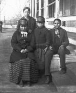 Four Sioux students soon after their arrival at the Carlisle Indian School, c.1879