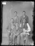 Visiting chief, three male students, and one white man, c.1885