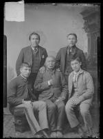 Three Native American men with two students, c.1890